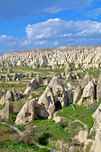 The photo was taken in Turkey in the spring. The picture shows the ancient cave dwellings in the mountains of Cappadocia.