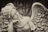 Worn statue in a graveyard