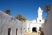 Whitewashed walls against bright blue sky in ancient city of Ghadames, Libya