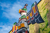 View of ancient colorful Totem Pole with blue sky behind it in Duncan, British Columbia, Canada.