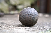 Ancient core for cannons and bullets. Antique historical artifact from the Middle Ages.