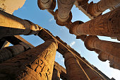 Sandstone pillers decorated with hieroglyphics at the Ancient Egyptian ( 2055 B.C ) temple of Karnak in Luxor