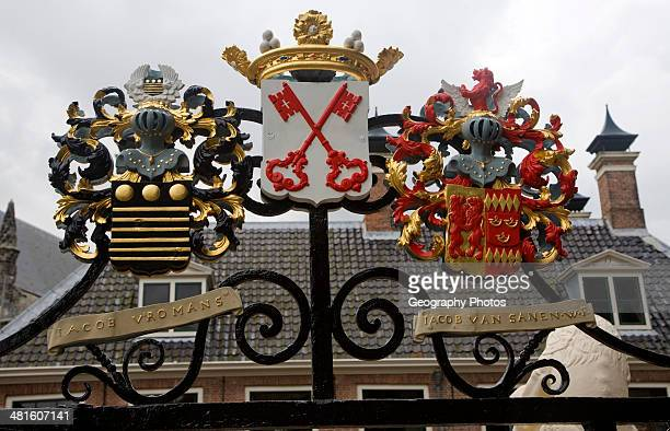 Ancient family coat of arms on railings at De Burcht historic site Leiden Netherlands with red crossed keys the coat or arms for Leiden