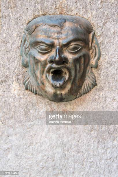 Ancient fountain in the form of a mask, Cremona