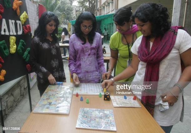 Ancient Games Exhibition Students try a game of snakes and ladders at the ancient games exhibit organised by the Department of Ancient Indian Culture...