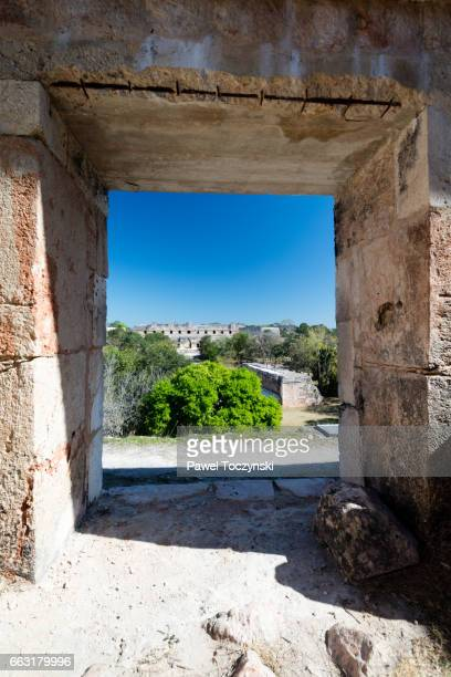 Ancient gate overlooking Uxmal Mayan site, Mexico