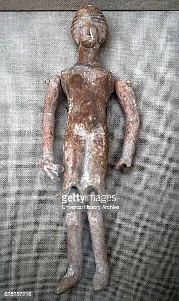 Ancient Greek terracotta dancing doll holding castanets Dated 4th Century BC