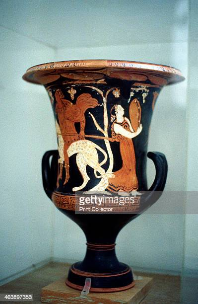 Ancient Greek vase with red figure decoration including a female dancer with a musical instrument similar to a tambourine 5th century BC
