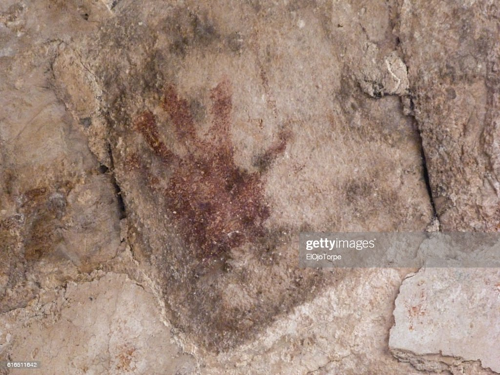 Ancient hand on wall in Uxmal ruins, Mexico : Stock Photo