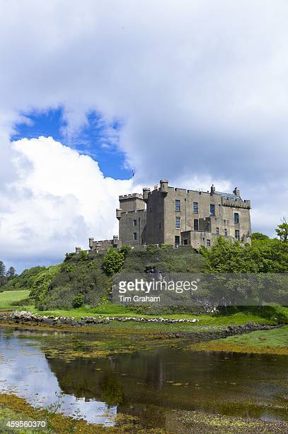 Ancient highland fortress Dunvegan Castle the Highlands ancestral home of the MacLeod clan by Dunvegan Loch a sea loch on the Isle of Skye in Scotland