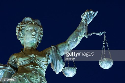 ancient Lady justice at night
