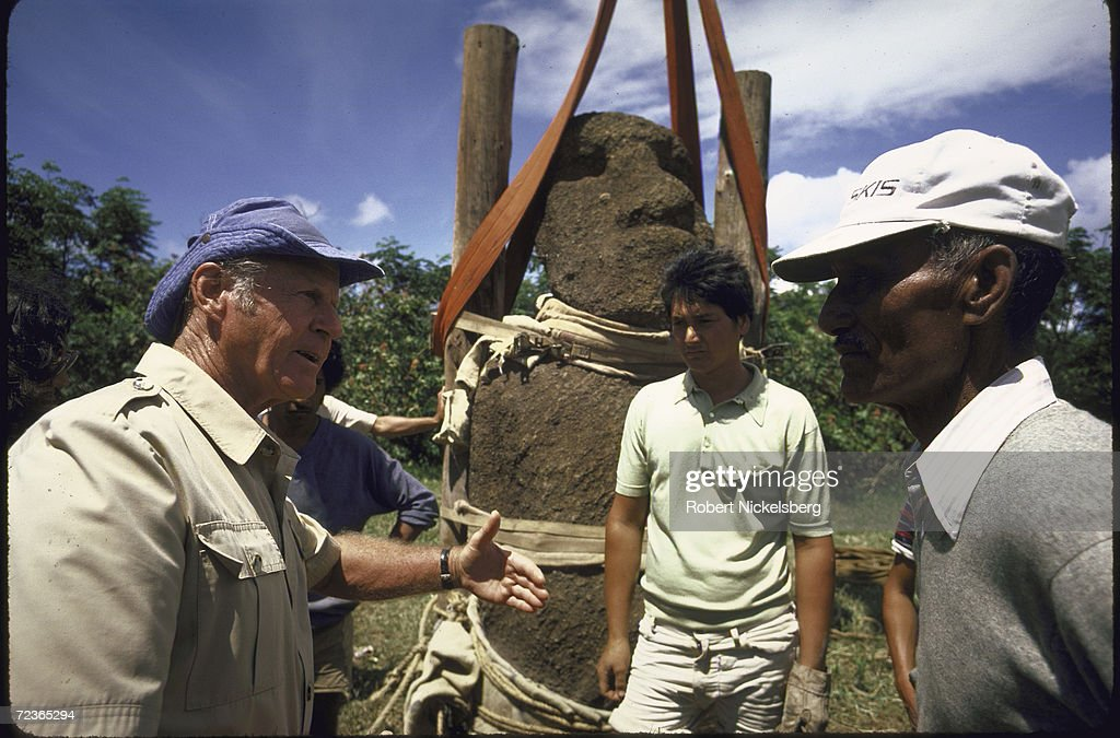 Ancient monolithic human bust with elongated heads on Easter Island being prepared for moving by workers from archaeological expedition headed by Norway's <a gi-track='captionPersonalityLinkClicked' href=/galleries/search?phrase=Thor+Heyerdahl&family=editorial&specificpeople=931459 ng-click='$event.stopPropagation()'>Thor Heyerdahl</a> (L). (Photo by Robert Nickelsberg/Time & Life Pictures/Getty Im