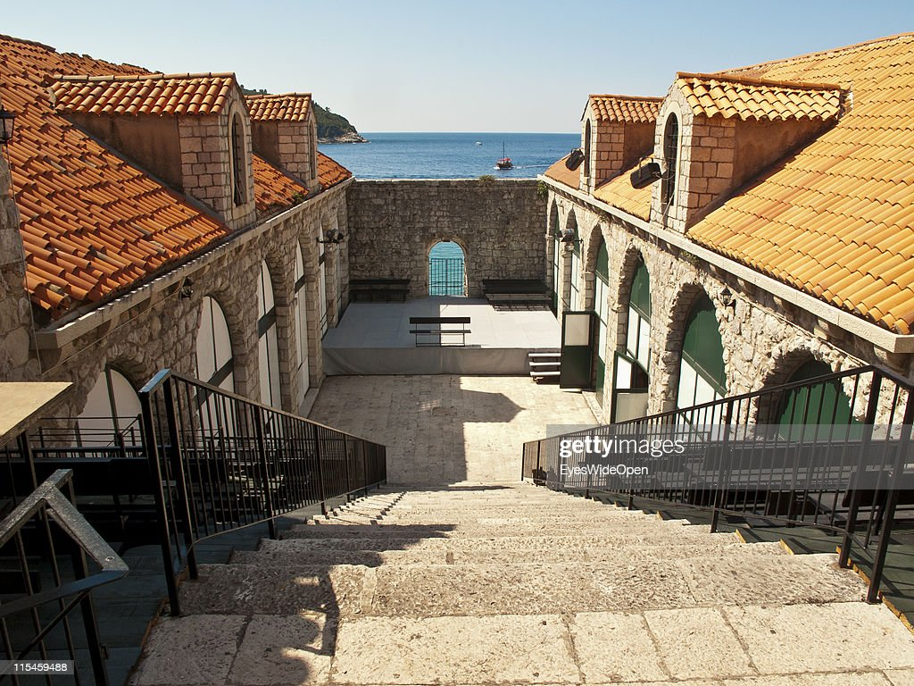 Ancient monuments and restored buildings with the typical roof tiles of the UNESCO World Heritage Site city of Dubrovnik on the Dalmatian coast of the Adriatic Sea on May 13, 2011 in Dubrovnik, Croatia. The old town is surrounded by a 1,9 km long city wall and called the Pearl of the Adriatic.