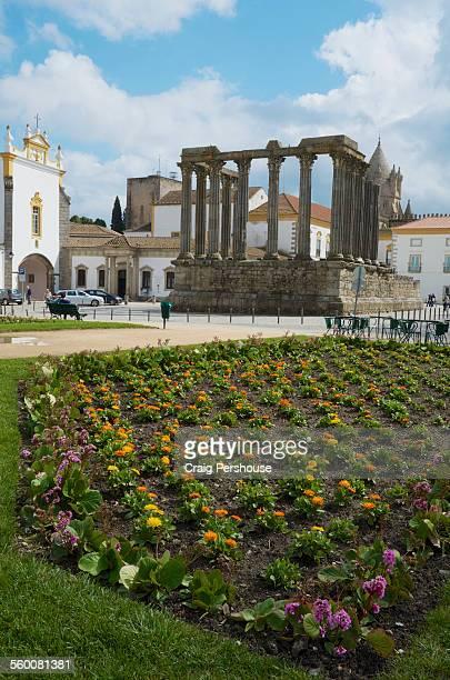 Ancient Roman Temple behind flower garden