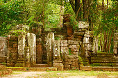 A dilapidated, abandoned temple found in the jungles of Siem Reap, Cambodia on a cloudy day.