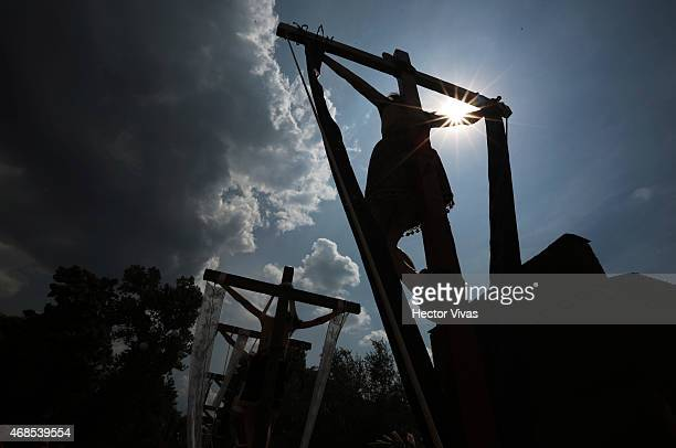 Ancient statues of Jesus Christ are raised during the representation of the Stations of the Cross as part of Holy Week celebrations in Mexico on...