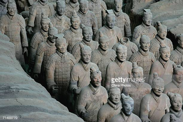 Ancient terracotta warriors stand in a pit at the Emperor Qin's Terracotta Warriors and Horses Museum on July 7 2006 in Lintong County of Shaanxi...