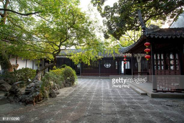 Ancient trees and opera stage in the backyard The Retreat Reflection Garden built in Qing Dynasty is a notable classical garden in China It is...