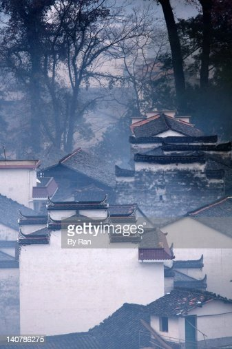 Ancient village in morning mist