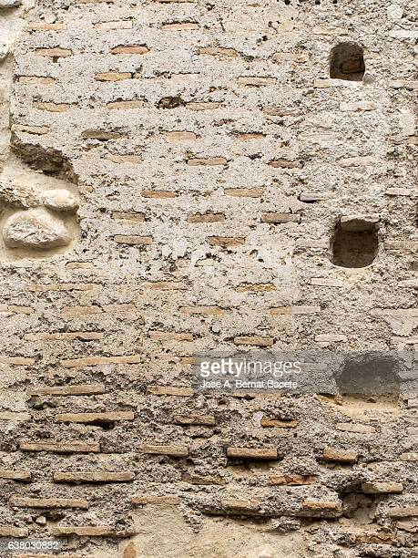 Ancient wall of adobe of Arabic medieval architecture.