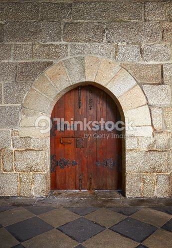 Ancient Wooden Door In Old Stone Castle In Guimaraes Portugal Stock ...