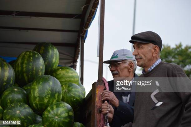 60 and 77yearold peddlers are pictured in front of their truck in Ankara Turkey on June 21 2017 The peddlers sell melons and watermelons on their...