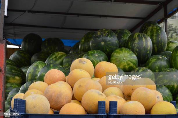 60 and 77yearold two peddlers sell melons and watermelons on their truck in the holy month of Ramadan in Ankara Turkey on June 21 2017