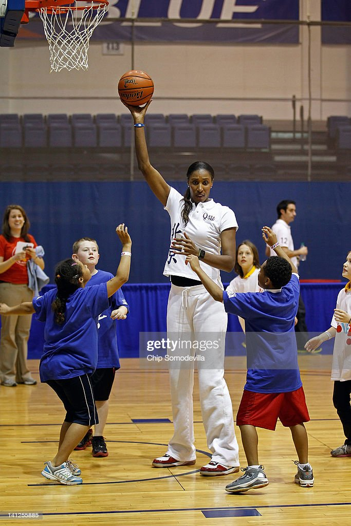 MVP and a four-time Olympic gold medal winner <a gi-track='captionPersonalityLinkClicked' href=/galleries/search?phrase=Lisa+Leslie&family=editorial&specificpeople=202228 ng-click='$event.stopPropagation()'>Lisa Leslie</a> plays basketball with area school children during an Olympics-themed event at American University March 13, 2012 in Washington, DC. Fifth graders from MacFarland Middle School in Washington, D.C., Manor View Elementary School in Maryland and Arlington Science Focus School in Virginia participated in a mini-Olympics competition in celebration of the 2012 London Summer Olympics and First Lady Michelle Obama's Let's Move! initiative.