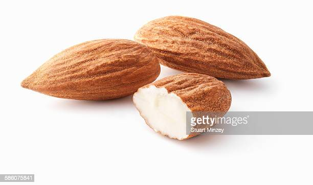 2 and a half almonds on white background