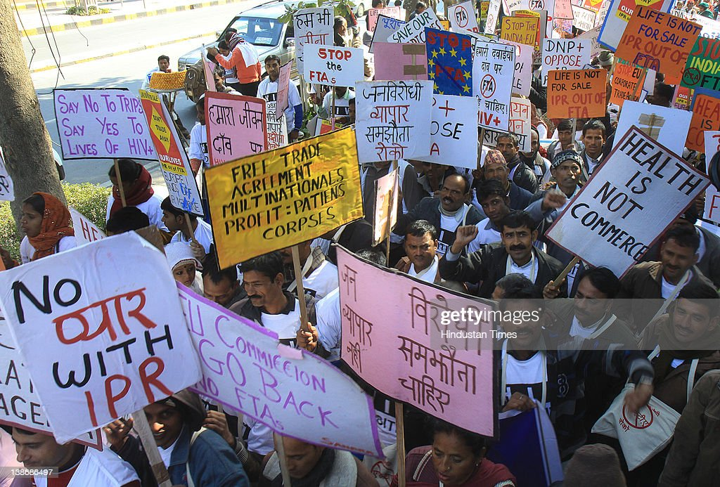 HIV and AIDS campaigners participate in a protest march from Mandi House to Jantar Mantar on February 10, 2012 in New Delhi, India. They were protesting against a proposed tree trade agreement between India and the European Union, claiming it will negatively impact the supply of affordable medicines.