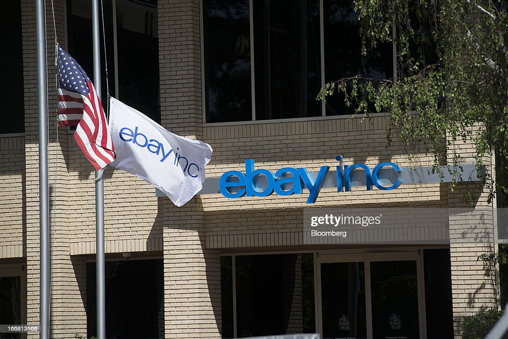 A U.S. and an eBay Inc. flag fly outside of the company's headquarters in San Jose, California, U.S., on Tuesday, April 16, 2013. Ebay Inc. is expected to release earnings data on April 17. Photographer: David Paul Morris/Bloomberg via Getty Images