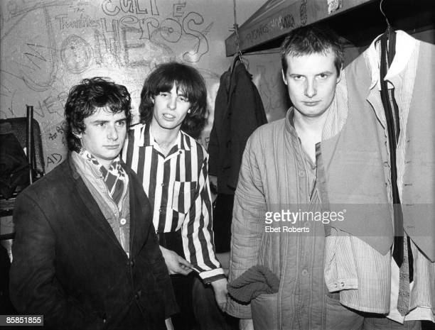 S Photo of XTC and Andy PARTRIDGE and Colin MOULDING and Terry CHAMBERS LR Terry Chambers Colin Moulding and Andy Partridge posed backstage