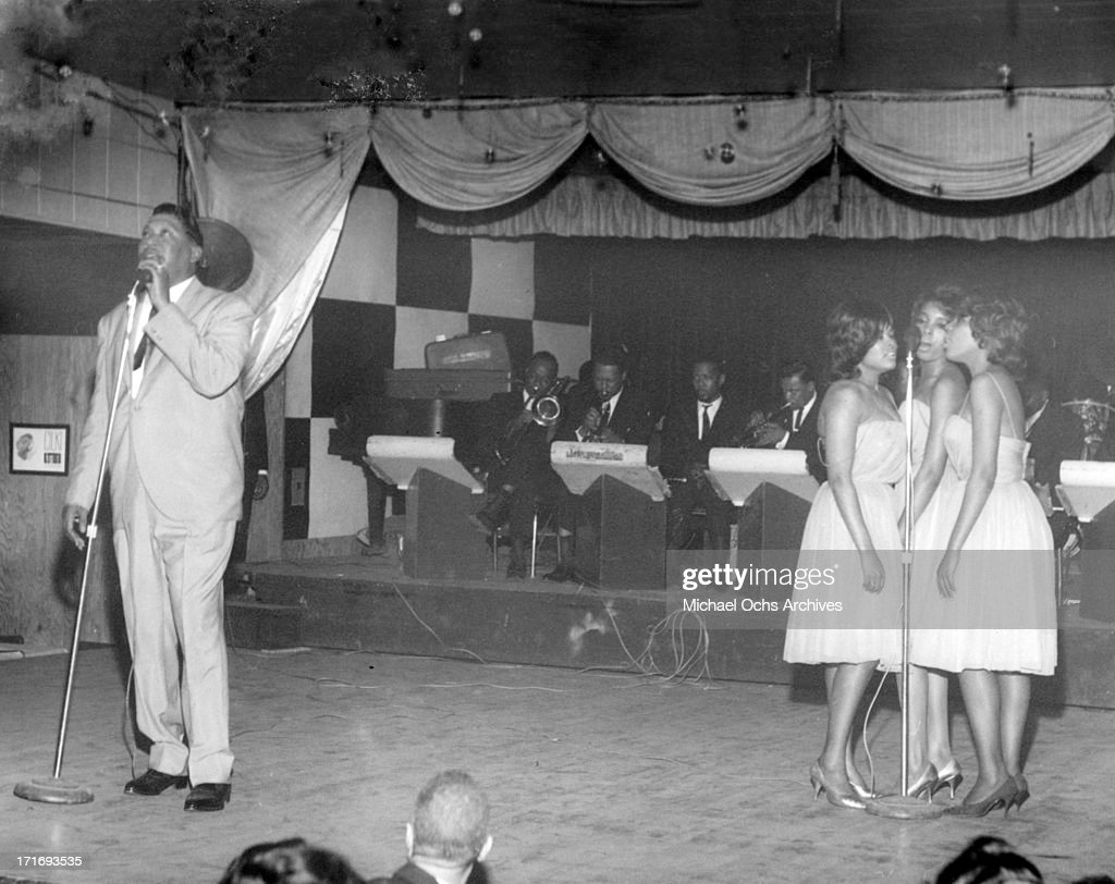 R and B musician Bobby 'Blue' Bland performs onstage with backup singers and a full band in circa 1964