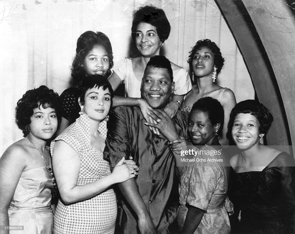 R and B musician Bobby 'Blue' Bland poses for a portrait with adoring female fans or groupies in circa 1964