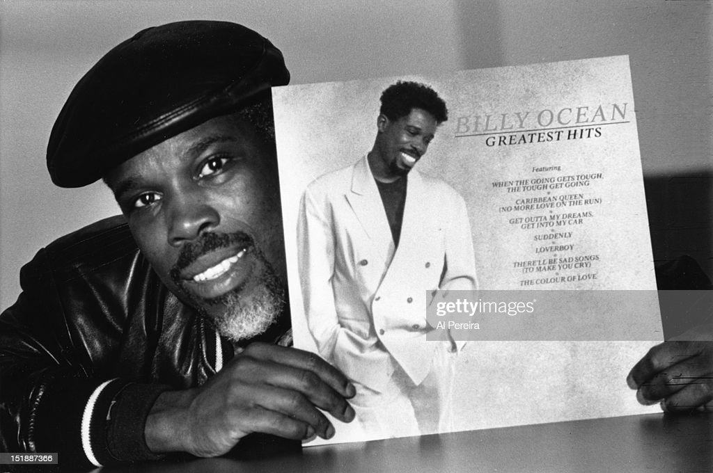 R and B singer Billy Ocean holds up a copy of his 'Greatest Hits' Album for a portrait in circa 1988.
