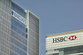 HSBC and Barclays bank headquarters buildings in Canary Wharf reflect early morning sunshine on August 3 2009 in London HSBC bank has announced a...