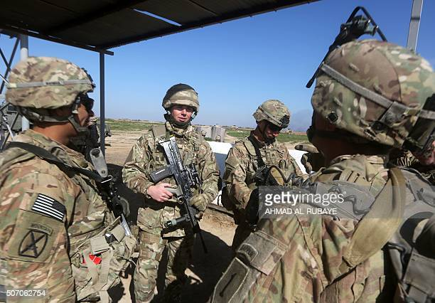US and British soldiers chat at the Basmaya base southeast of the Iraqi capital Baghdad on January 27 as the USled coalition forces train Iraq's 72nd...