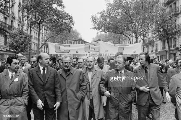 CGT and CFDT Union leaders Henri Krasucki Benoît Frachon André Berthelot Georges Seguy and Fredo Krumnow march towards Place de la Republique on...
