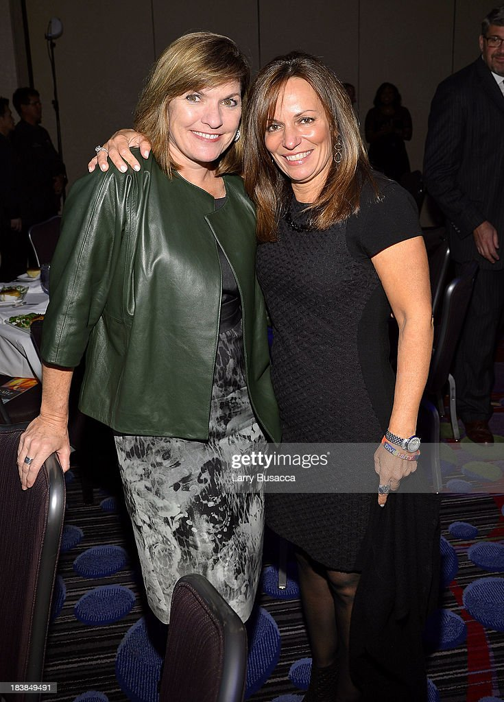 EVP and Chief Communications Officer at Time Warner Cable Ellen East (L) and President & CEO of WICT Maria Brennan attend the 30th Annual Walter Kaitz Foundation Fundraising Dinner at The New York Marriott Marquis on October 9, 2013 in New York City.