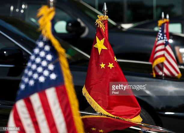 S and China national flags adorn the motorcade of US Vice President Joe Biden as he arrives at the Zhongnanhai leaders compound on 19 August 2011 in...