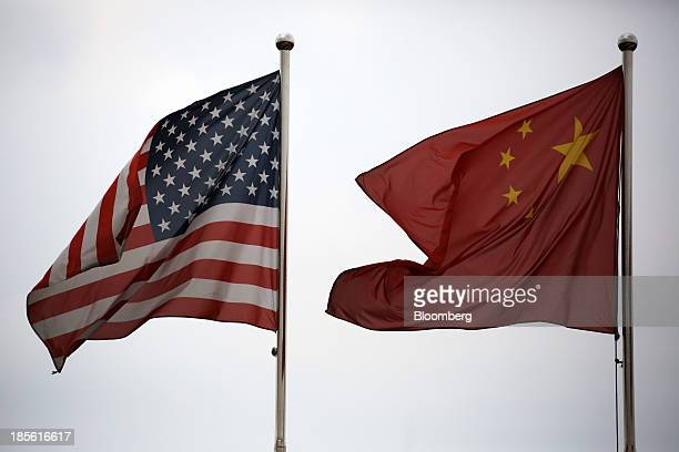 US and Chinese national flags fly outside a company building in the China Pilot Free Trade Zone's Waigaoqiao free trade zone and logistics park in...