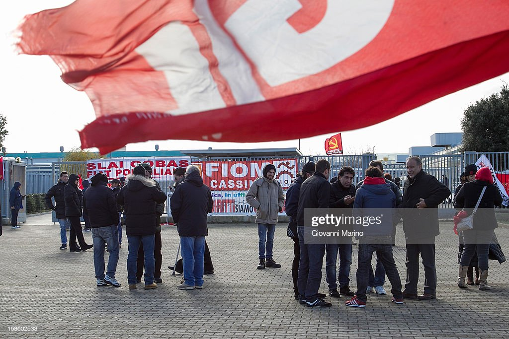 FIOM and COBAS union members protest outside the the Fiat plant during the visit of Italian Prime Minister Mario Monti and Fiat CEO Sergio Marchionne on December 20, 2012 in Melfi, Italy. The visit comes as the car maker's chief executive, Sergio Marchionne, announced plans to build new sport utility vehicles (SUV) at its Melfi plant by year-end.