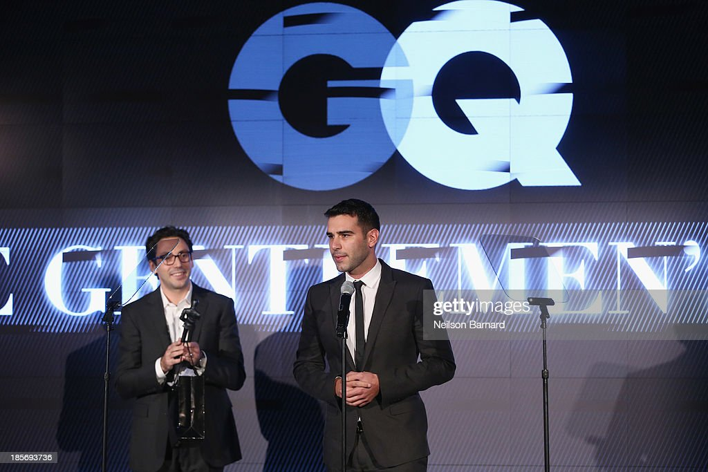 CEO and co-founder of Warby Parker Neil Blumenthal and GQ Leader Awards Winner Adam Braun speak onstage at the 2013 GQ Gentlemen's Ball presented by BMW i, Movado, and Nautica at IAC Building on October 23, 2013 in New York City.