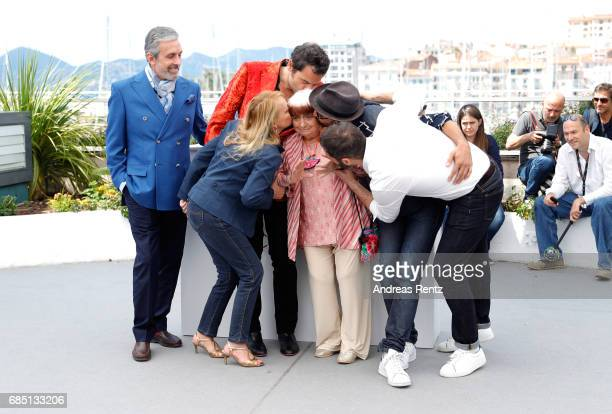 JR and composer Matthieu Chedid are hugging director Agnes Varda as they attend 'Faces Places ' photocall during the 70th annual Cannes Film Festival...