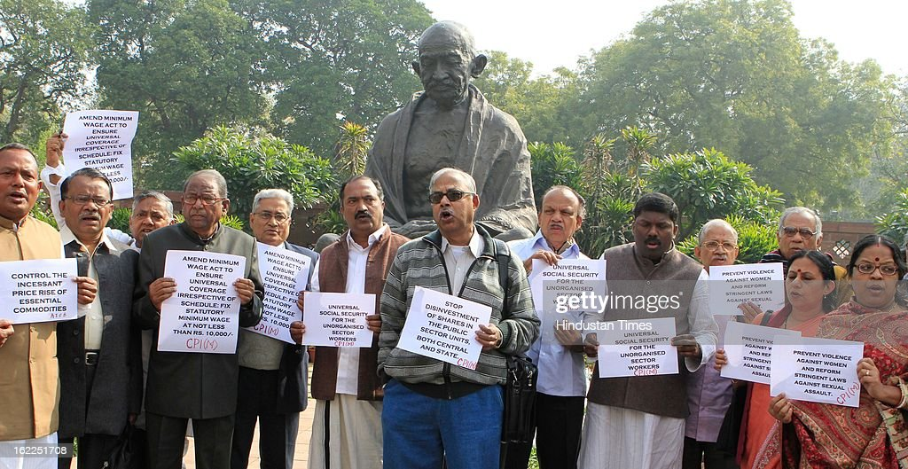 CPIM and CPI MPs demonstrating in front of Gandhi statue at Parliament in support of trade unions strike during the opening day of Budget session on February 21, 2013 in New Delhi, India.