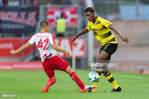 RWE 42 and DanAxel Zagadou of Dortmund battle for the ball during the preseason friendly match between RotWeiss Essen and Borussia Dortmund at...