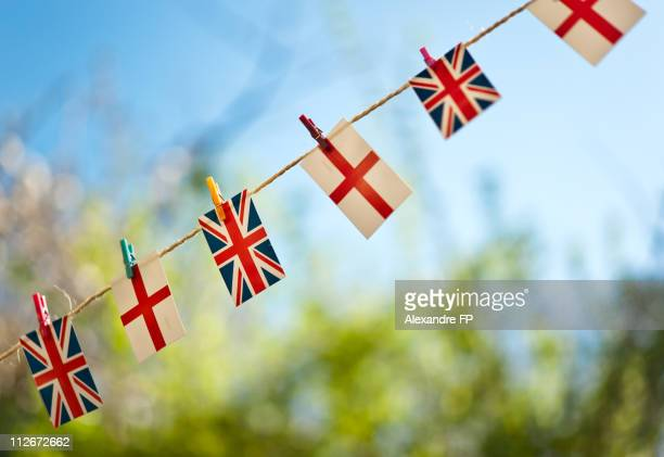 UK and English flags on rope line