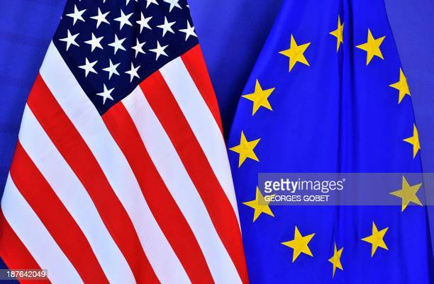US and EU flags are pictured on November 112013 at the EU Headquarters Europeans and Americans restart their discussions today to establish a...