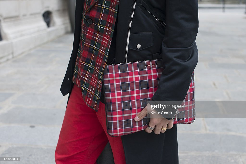 DJ, MC and Fashion blogger Peter Xu wears 5cm trousers, a Comme des Garcons jacket and tops with a Givenchy clutch bag on day 3 of Paris Collections: Men on June 28, 2013 in Paris, France.