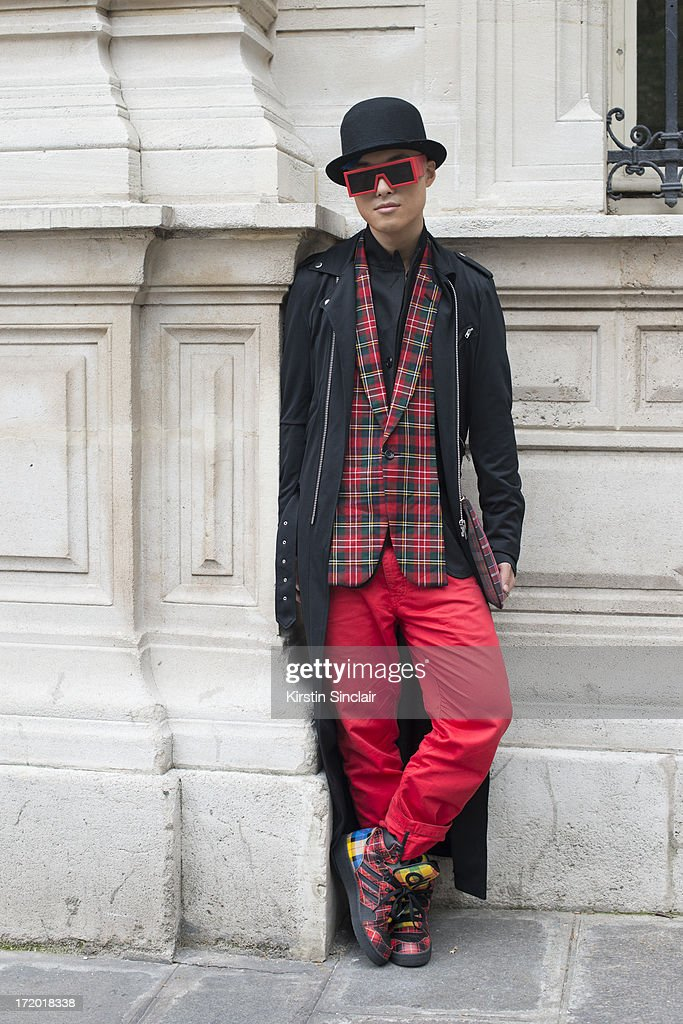 DJ, MC and Fashion blogger Peter Xu wears Adidas trainers, 5cm trousers, a Comme des Garcons jacket, Rad Hourani with Mikita sunglasses, Givenchy clutch bag and a Henry Vibskov on day 3 of Paris Collections: Men on June 28, 2013 in Paris, France.